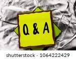 Small photo of Text sign showing Q A. Conceptual photo Ask Frequently Faq Asked Question Help Solving Doubt Query Support written on Stacked Sticky Note Paper on the Silver textured background.