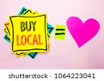 text sign showing buy local.... | Shutterstock . vector #1064223041
