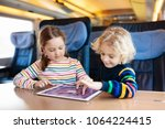 child traveling by train.... | Shutterstock . vector #1064224415
