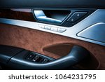 car black perforated leather... | Shutterstock . vector #1064231795