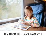 child traveling by train....   Shutterstock . vector #1064235044