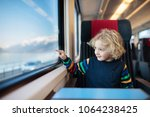 child traveling by train.... | Shutterstock . vector #1064238425