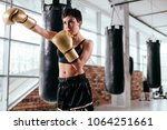 nice woman is keen on boxing.... | Shutterstock . vector #1064251661