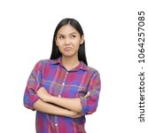 Small photo of Portrait of young asian girl pout and looking up, frowning and pouting. Stubborn teenage girl looking angry or irritated. With clipping path