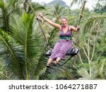 caucasion woman having fun at... | Shutterstock . vector #1064271887