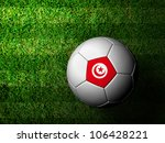 Tunisia Flag Pattern 3d rendering of a soccer ball in green grass - stock photo