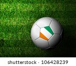 Ivory Coast Flag Pattern 3d rendering of a soccer ball in green grass - stock photo