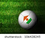 Niger Flag Pattern 3d rendering of a soccer ball in green grass - stock photo