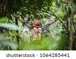 happy young woman raising her...   Shutterstock . vector #1064285441