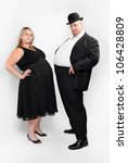 Two overweight business people. Competition and sexism concept. - stock photo