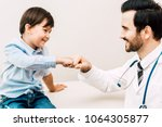doctor giving fist bump with... | Shutterstock . vector #1064305877