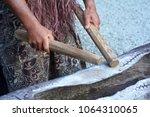 cook islander man plays on a... | Shutterstock . vector #1064310065