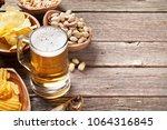 lager beer mug and snacks on...   Shutterstock . vector #1064316845