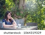 business woman writing on book... | Shutterstock . vector #1064319329