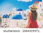 tourist traveling in santorini  ... | Shutterstock . vector #1064319371