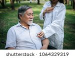 nurse looking at elderly...   Shutterstock . vector #1064329319