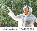rainy day asian woman wearing a ... | Shutterstock . vector #1064352521