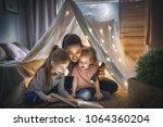 family bedtime. mom and...   Shutterstock . vector #1064360204