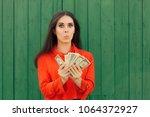 funny casual girl holding money ... | Shutterstock . vector #1064372927