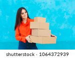 woman with many cardboard boxes ... | Shutterstock . vector #1064372939