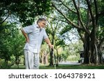 old man with cane suffering... | Shutterstock . vector #1064378921