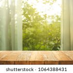 empty of wood table top on blur ... | Shutterstock . vector #1064388431