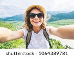 beautiful happy girl traveler... | Shutterstock . vector #1064389781