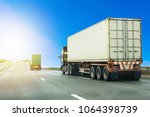 truck on highway road with... | Shutterstock . vector #1064398739