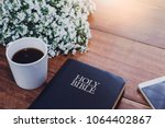 Holy Bible With A Cup Of Coffe...