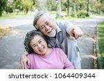 senior man caring for  disabled ...   Shutterstock . vector #1064409344