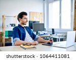young designer working with... | Shutterstock . vector #1064411081