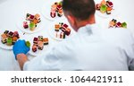professional confectioner puts... | Shutterstock . vector #1064421911