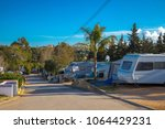 campground in south europe with ... | Shutterstock . vector #1064429231
