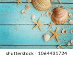 seashells and sand on blue... | Shutterstock . vector #1064431724