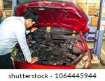 man with engine on car service... | Shutterstock . vector #1064445944