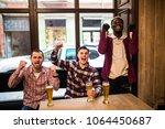 watching tv in pub. happy young ...   Shutterstock . vector #1064450687