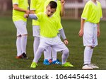 kids soccer football   young... | Shutterstock . vector #1064454431