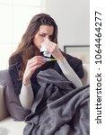 woman with flu virus lying on... | Shutterstock . vector #1064464277