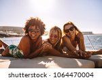 multiracial group of females... | Shutterstock . vector #1064470004