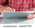man using digital tablet  close ... | Shutterstock . vector #106447799