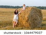 mom and daughter walking in the ... | Shutterstock . vector #1064479037