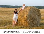 mom and daughter walking in the ... | Shutterstock . vector #1064479061