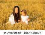 mom and daughter walking in the ... | Shutterstock . vector #1064480834