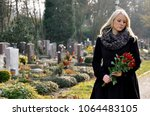woman in cemetery with a... | Shutterstock . vector #1064483105