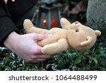 woman in cemetery in deep... | Shutterstock . vector #1064488499