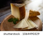 cured cheese on board | Shutterstock . vector #1064490329
