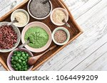 different super foods in bowls... | Shutterstock . vector #1064499209