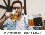 the guy drinks three different... | Shutterstock . vector #1064513624