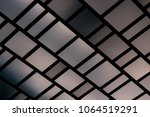 Small photo of Pattern on building of chromic squares