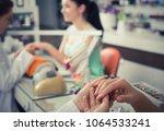 woman hands in nail salon... | Shutterstock . vector #1064533241
